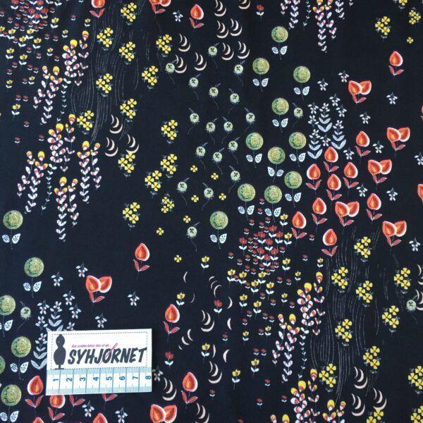 Vævet bomuld med lycra med blomsterranker på sort bund