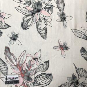 Bomuldsjersey med store grå-laksefarvede blomster