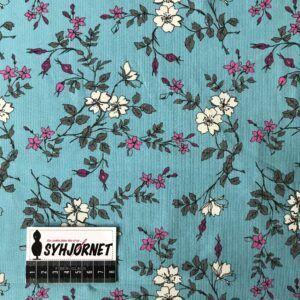 bomuldsjersey blomster på turkis bund