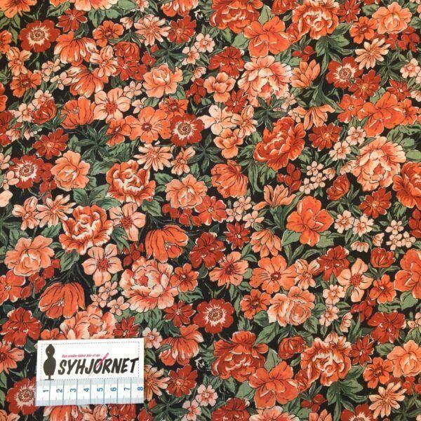 Flot vævet viskose med smukke orangefarvede blomster fra italiensk modehus