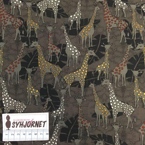 Bomuldsjersey med giraffer med hvide, gule og orange pletter.