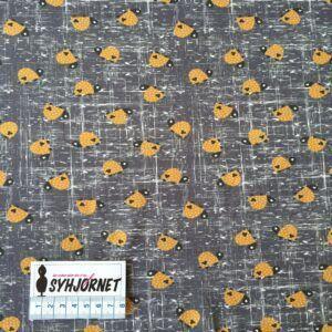 Bomuldsjersey med små okkerfarvede skildpadder økotex 100