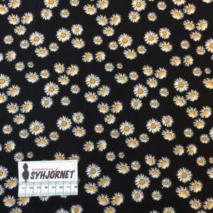 Viskose vævet med margueritter på sort bund
