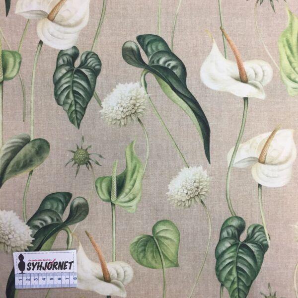 Bomuld vævet med print kalla blomster og blade.