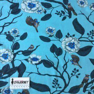 bomuldsjersey blomstergrene og fugle på lys blå bund