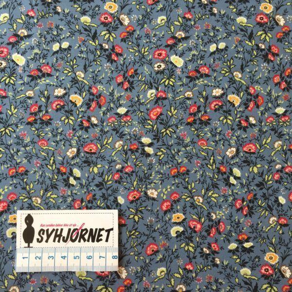 Liberty bomulds poplin grå bund med røde og karrygule blomster økotex 100